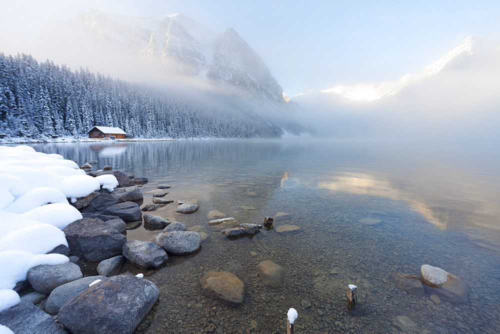 Foggy sunrise at Lake Louise, Banff National Park, UNESCO World Heritage Site, Rocky Mountains, Alberta, Canada, North America