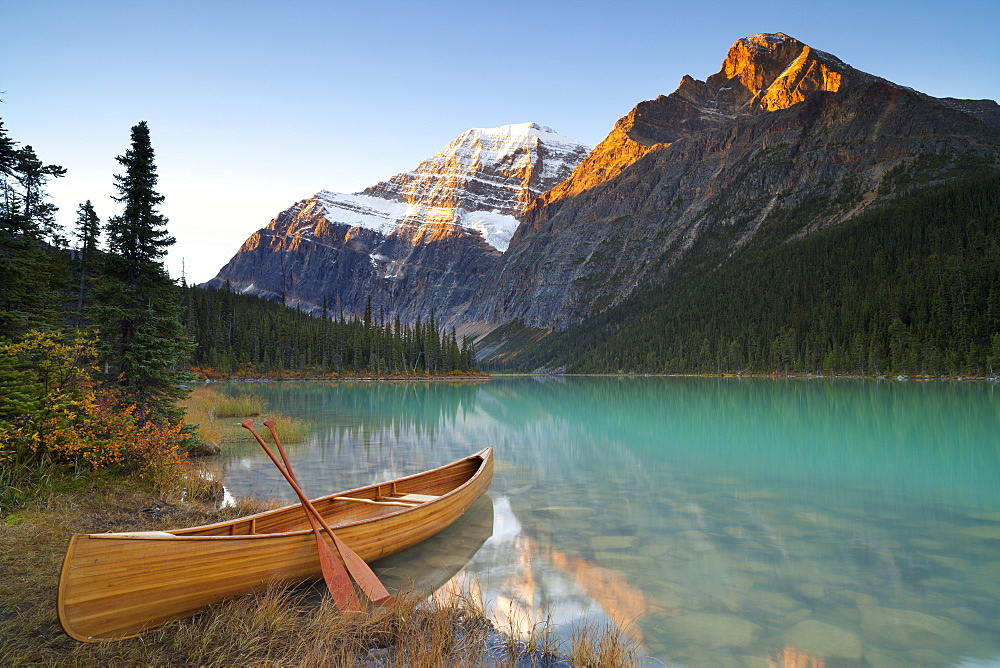 Canoe at Cavell Lake with Mount Edith Cavell in the background, Jasper National Park, UNESCO World Heritage Site, Rocky Mountains, Alberta, Canada, North America