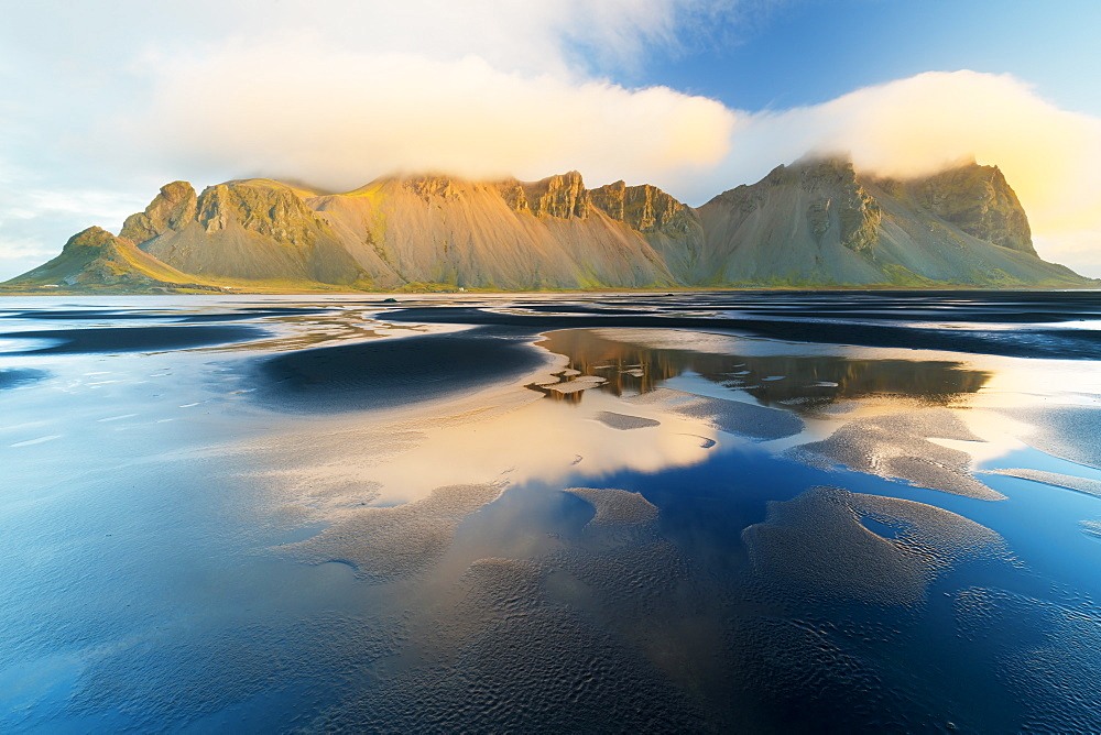Mount Vestrahorn shrouded in clouds at sunrise, Stokksnes, Iceland, Polar Regions