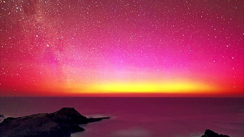 Red Aurora Australis - EPOTY 2012 video entry *** Local Caption *** Charged particles from the Sun excited oxygen atoms high in the Earth's atmosphere and produced beautiful display of the Southern Lights (Aurora Australis)  above the Southern Ocean recor - 1150-1