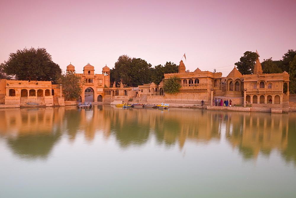 Gadi Sagar illuminated at dusk, Jaisalmer, Western Rajasthan, India, Asia