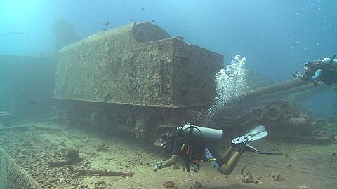 locomotive car on deck of Thistlegorm wreck with divers