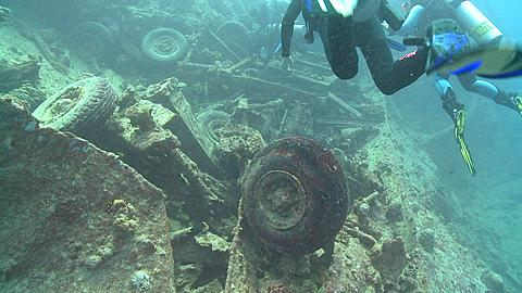 Divers past camera and over wreck of Thistlegorm