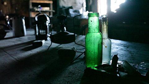 Bottles on table in Scott's Hut, Ross Island, Antarctica