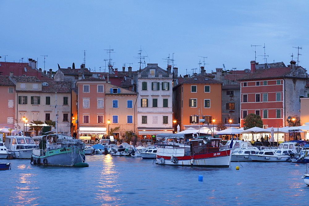 Waterfront and harbour with ships and boats at dusk, Rovinj, Istria, Croatia, Europe