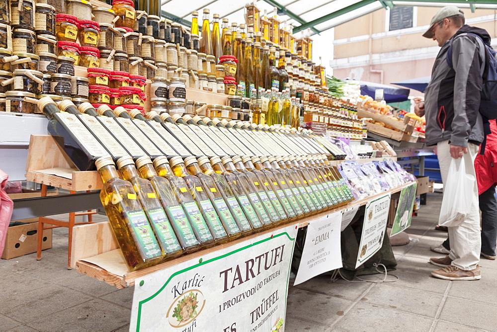 Truffles and bottles of olive oil selling on the market, Rovinj, Istria, Croatia, Europe