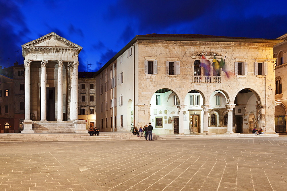 Illuminated Temple of Augustus and town hall on the marketplace in the old town at night, Pula, Istria, Croatia, Europe
