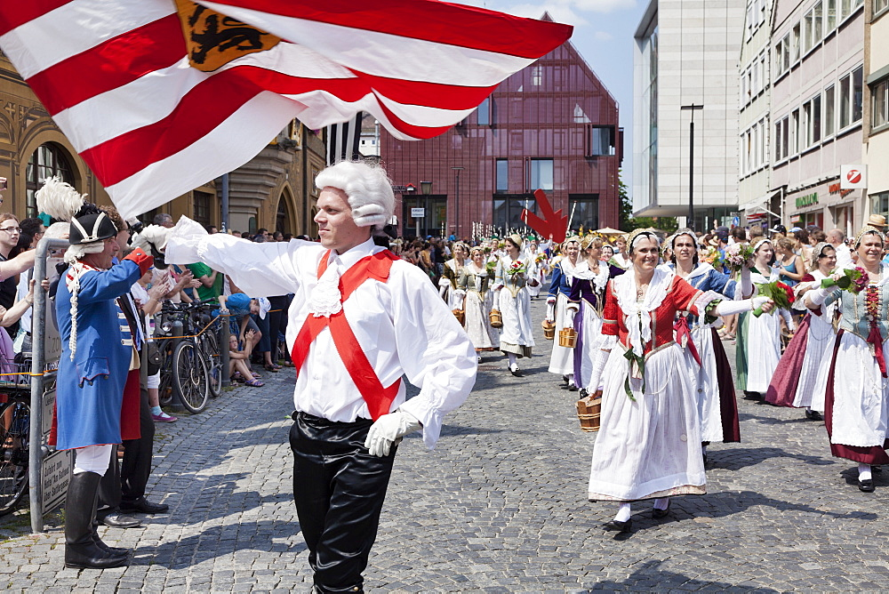 Flag thrower and fisher women in a historical parade at the market place, Fischerstechen, Ulm, Baden Wurttemberg, Germany, Europe