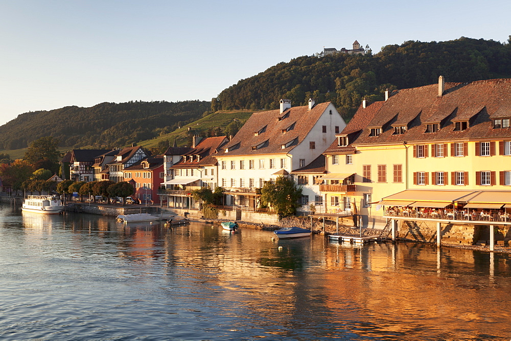 Old town along the Rhine promenade with Burg Hohenklingen castle at sunset, Stein am Rhein, Canton Schaffhausen, Switzerland, Europe