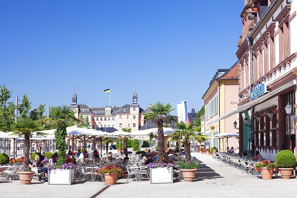 Street cafes and Schloss Schwetzingen Palace, Schwetzingen, Rhein-Neckar-Kreis, Baden Wurttemberg, Germany, Europe