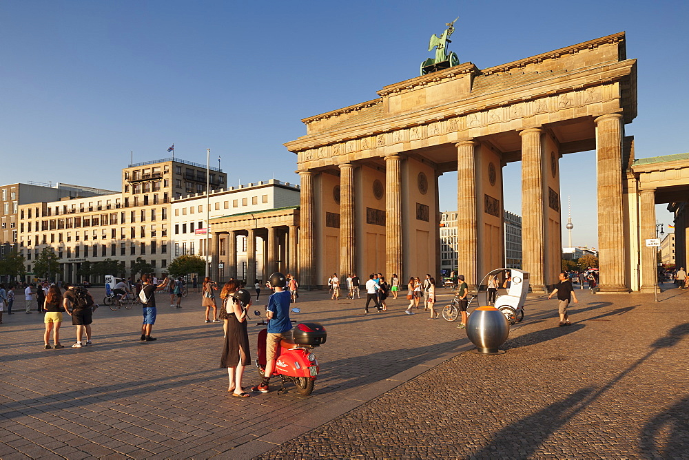 Brandenburg Gate (Brandenburger Tor) at sunset, Platz des 18 Marz, TV Tower, Berlin Mitte, Berlin, Germany, Europe