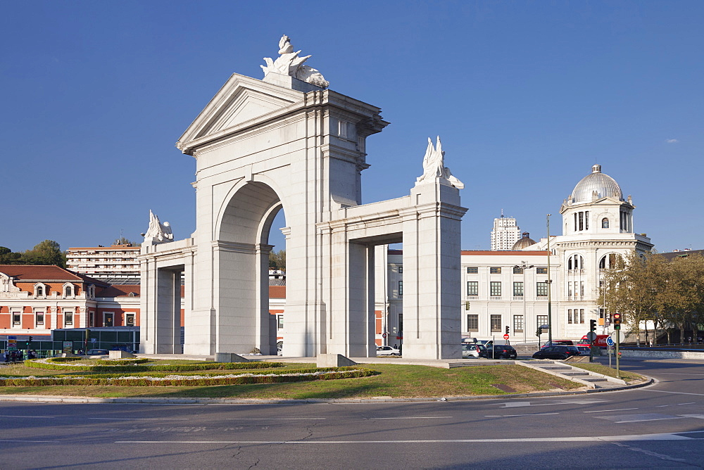 Puerta de San Vicente Gate with Principe Pio Station, Glorieta de San Vicente in the background, Madrid, Spain, Europe
