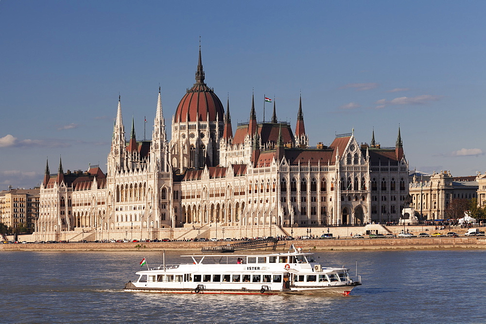 Excursion boat on the Danube River, Parliament Building at sunset, UNESCO World Heritage Site, Budapest, Hungary, Europe