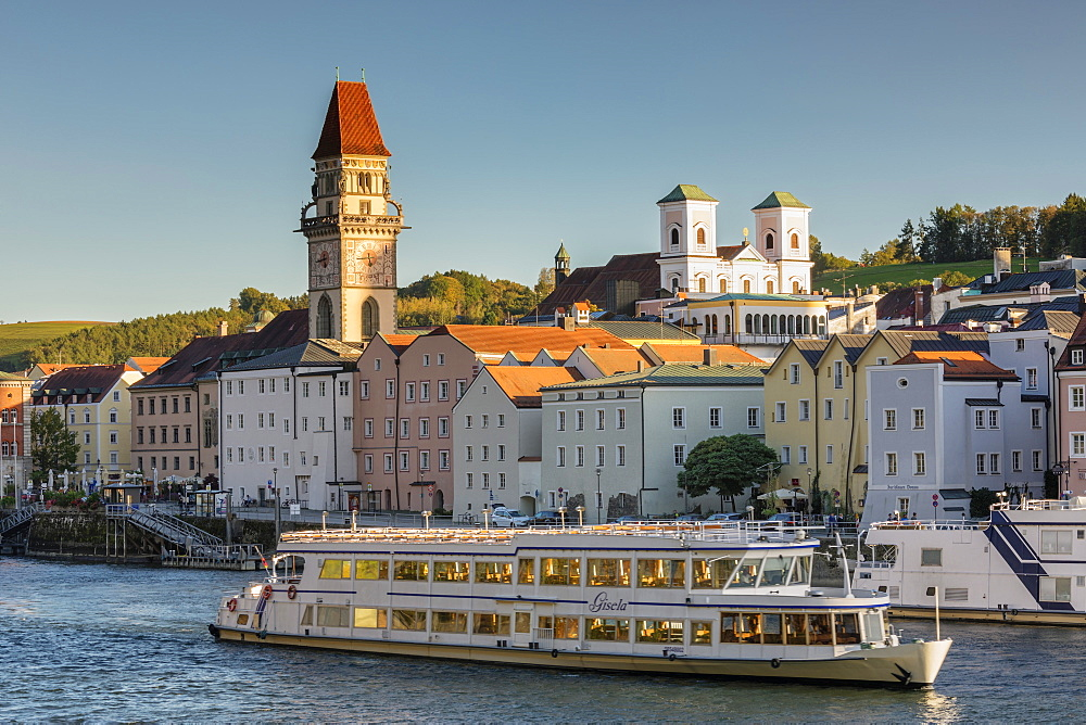 Boat on Danube, town hall and church in Passau, Bavaria, Germany, Europe