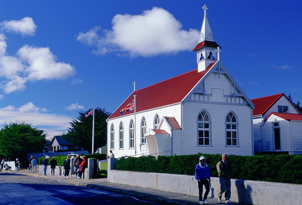 People walking along Main Street in Port Stanley, Falkland Islands