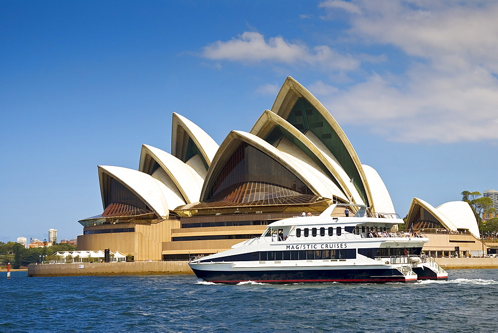 Power boat passes Sydney Opera House in Sydney Harbour, Australia