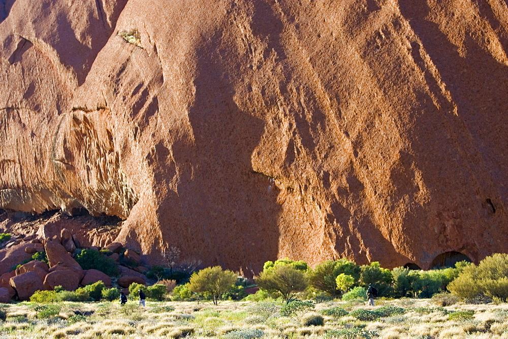 Tourists at the base of Ayers Rock, Uluru, Australia