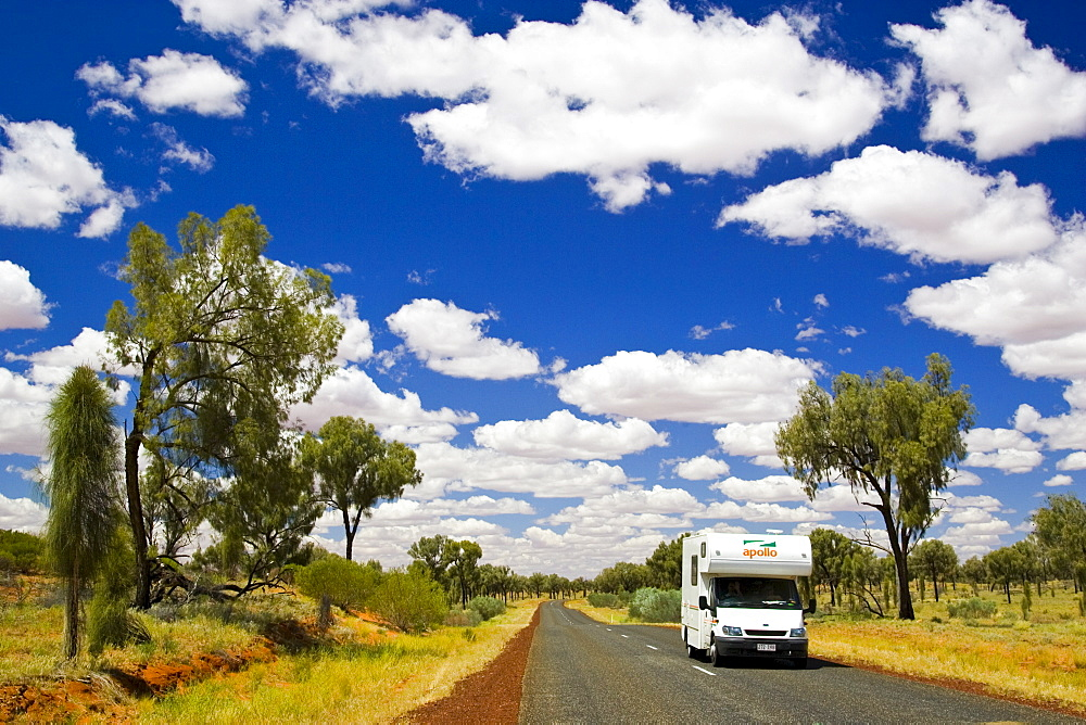 Motorhome travels road in the Red Centre, Northern Territory, Australia
