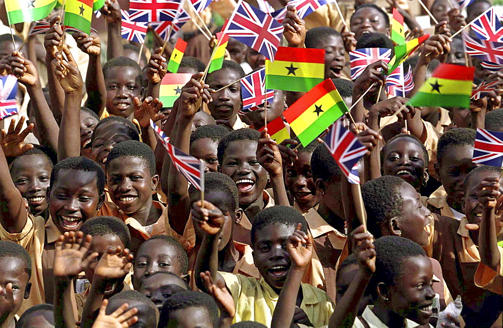 Children in Accra waving British and Ghana flags