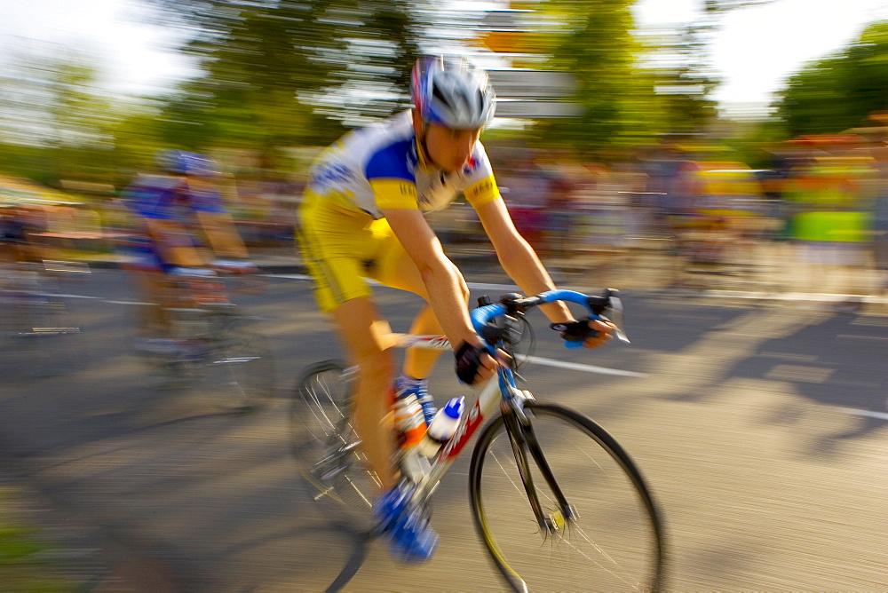 Cyclist takes part in Le Prix De La Ville De Lucmau in France