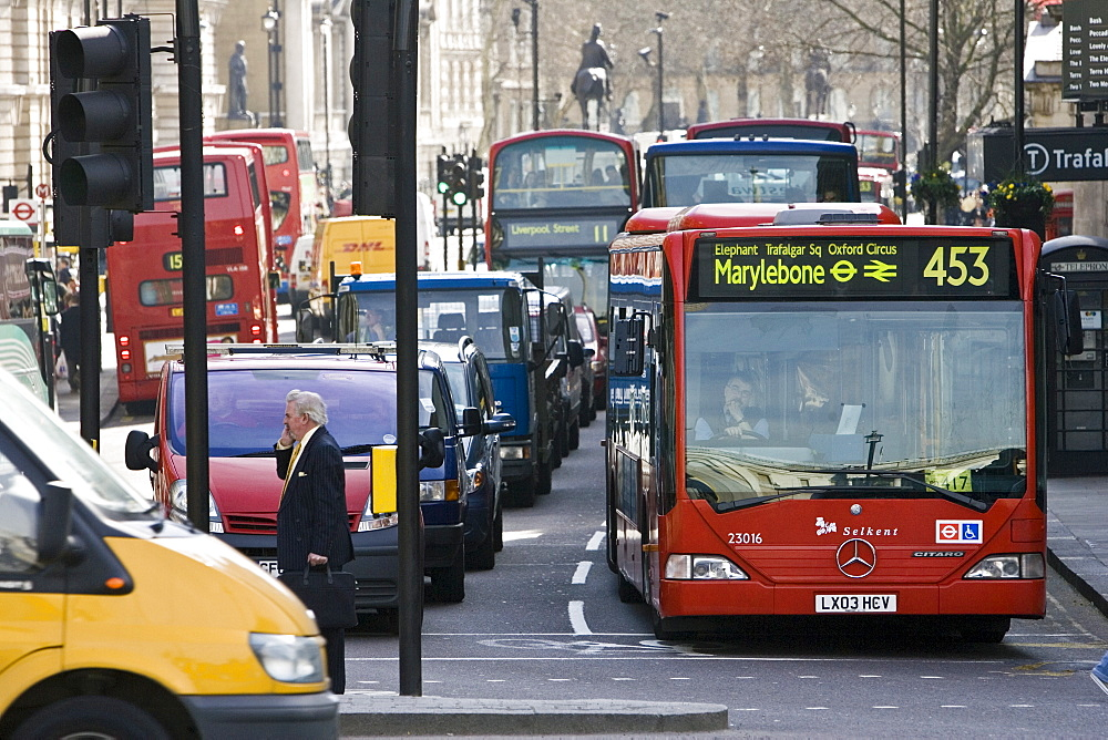 Heavy traffic at a standstill at traffic lights in Trafalgar Square, London city centre, England, United Kingdom
