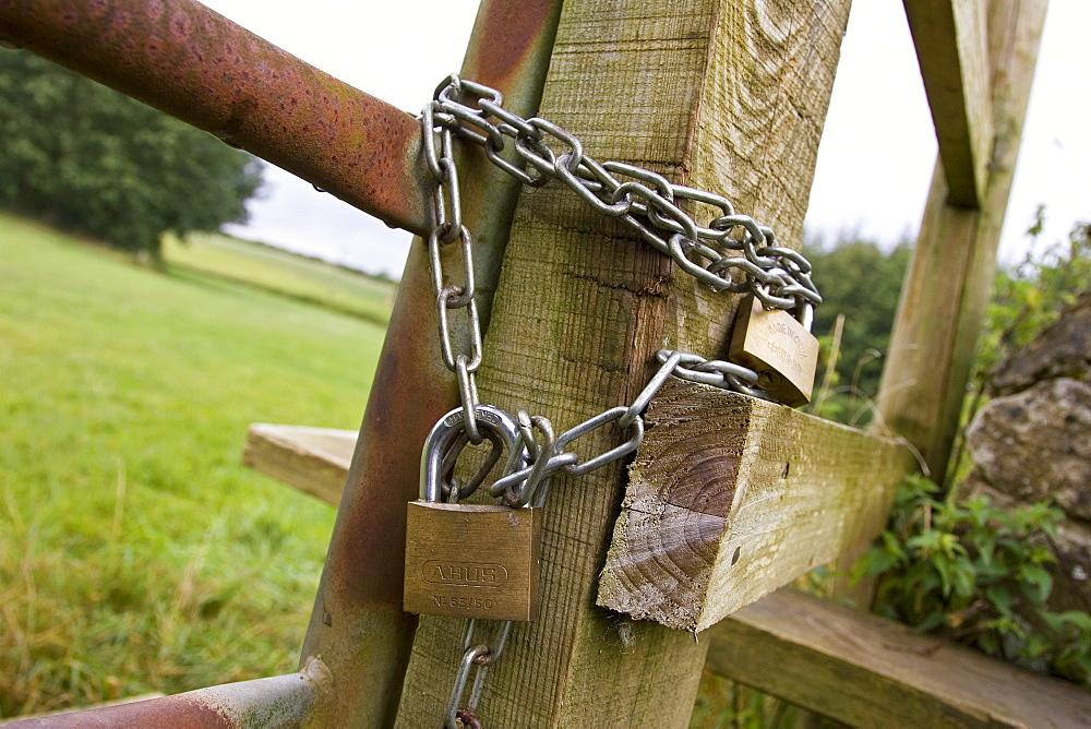 Gate locked with padlocks and a chain, Oxfordshire, United Kingdom