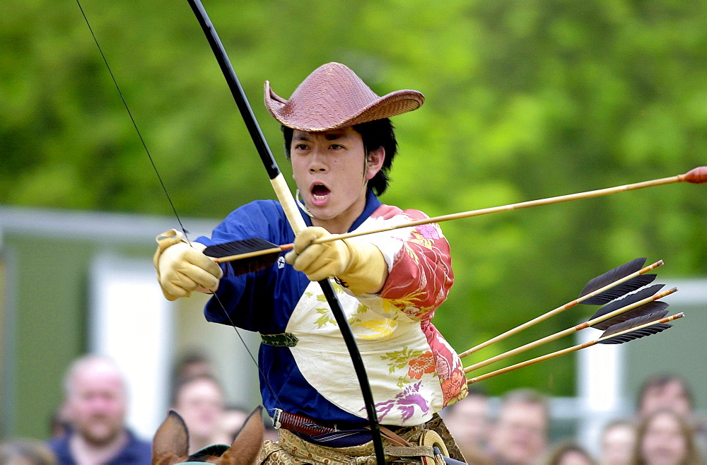 Japanese horseman giving a traditional display of horse riding skills and use of bow and arrows during the exhibition ' matsuri japan in the park ' in hyde park, london.