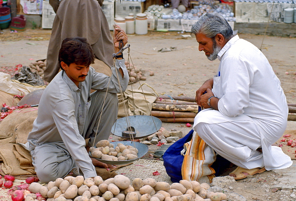 Man buying potatoes, Pakistan