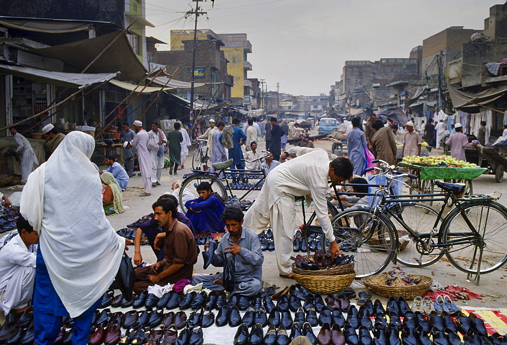 Shoes on sale at a street market, Islamabad, Pakistan.