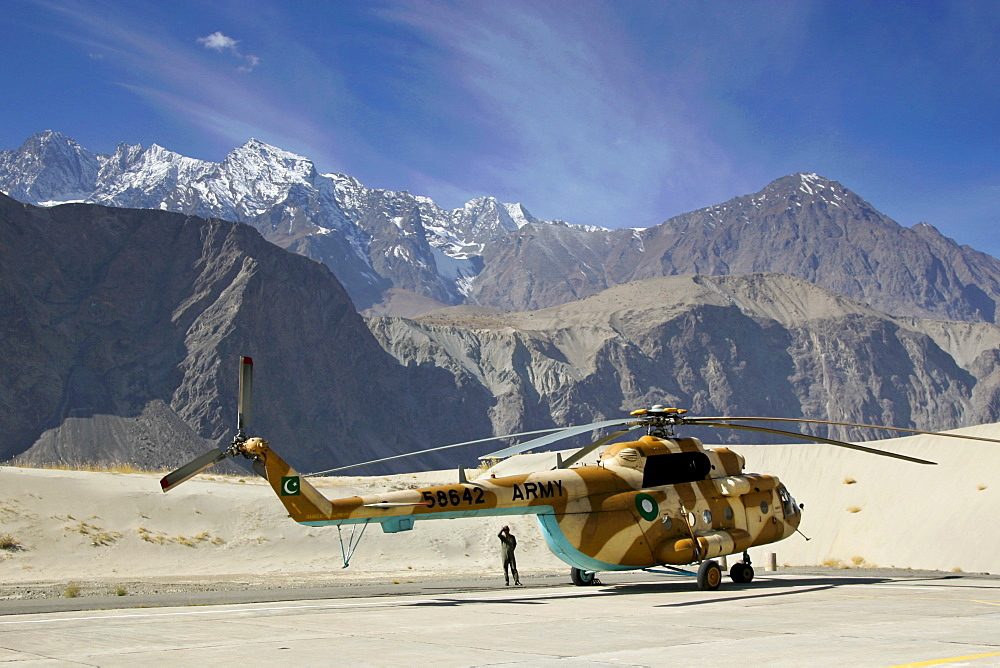 Helicopter on heliport in valleys of Karokoram Mountains, Skardu Valley, North Pakistan