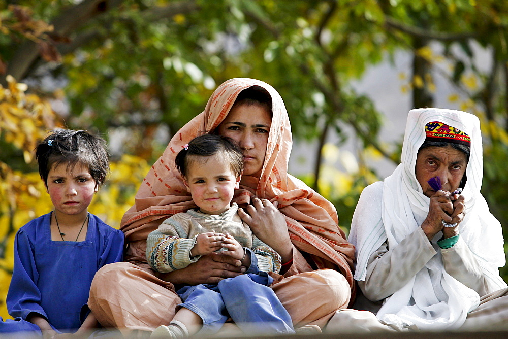 Pakistani family in mountain village of Altit in Hunza region of Karokoram Mountains, Pakistan
