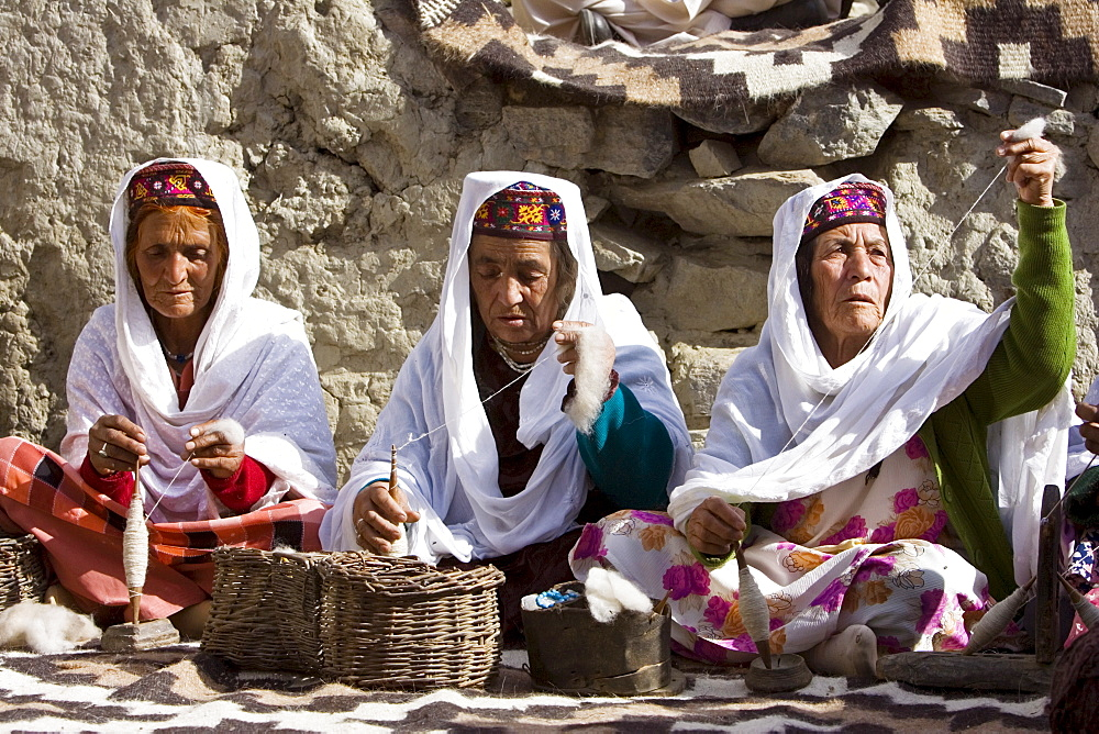 Women spin wool together in mountain village of Altit in Hunza region of Karokoram Mountains, Pakistan