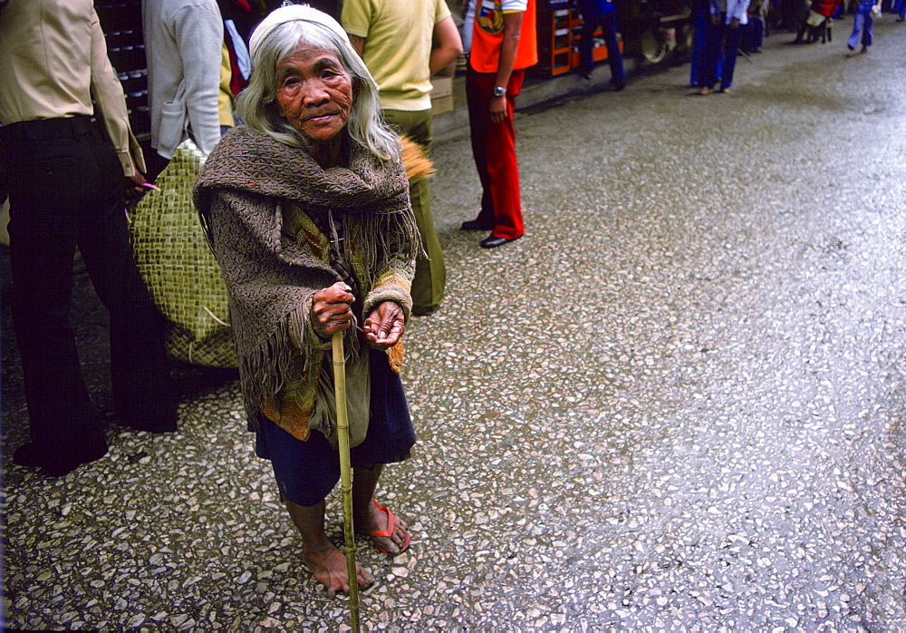 Elderly woman begging in the streets of Baguio, Northern Luzon, Philippines