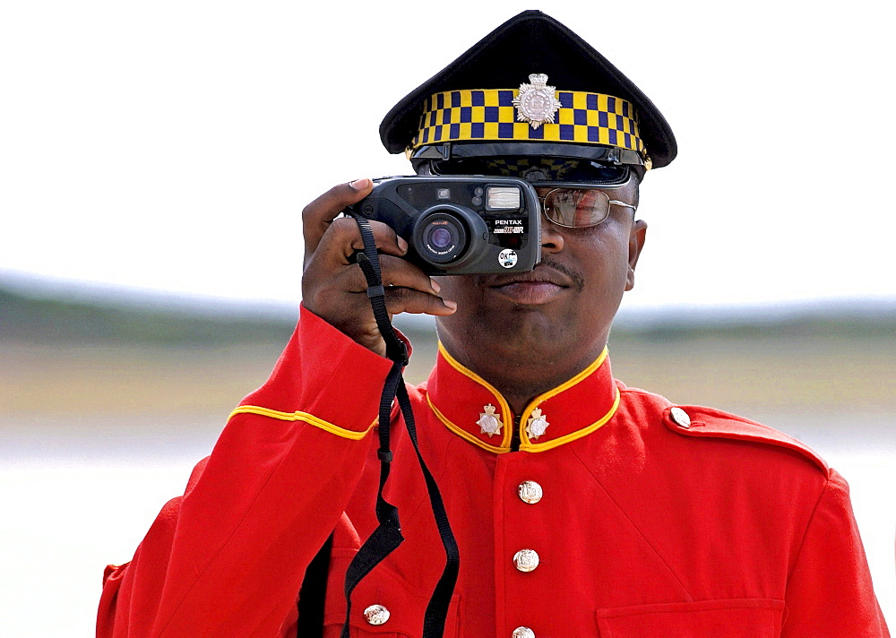 Soldier from the Jamaica Defence Force taking a photograph during parade