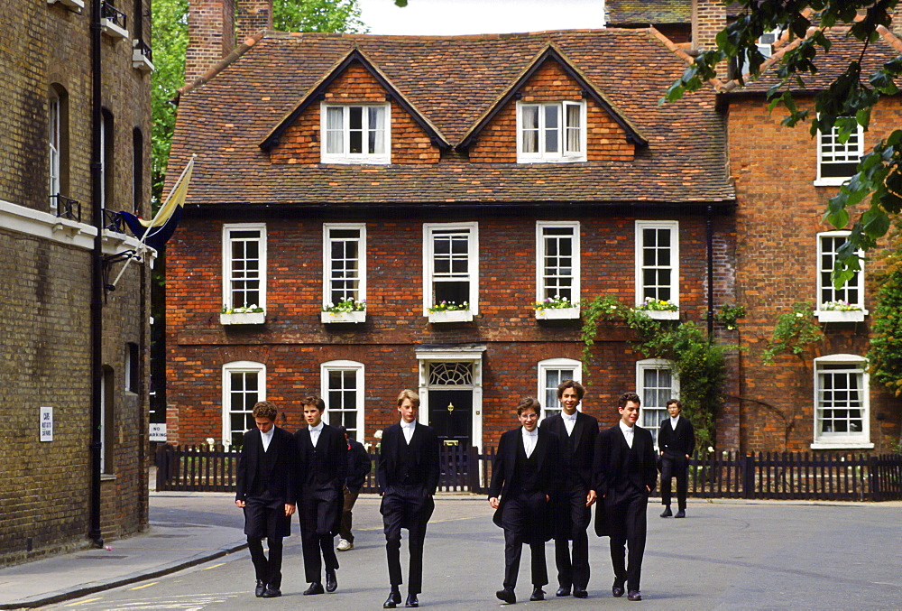 Eton schoolboys in traditional tailcoats at Eton College boarding school, Berkshire, UK.