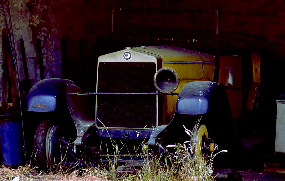 Vintage Fiat car awaiting restoration in a barn in Gloucestershire,England