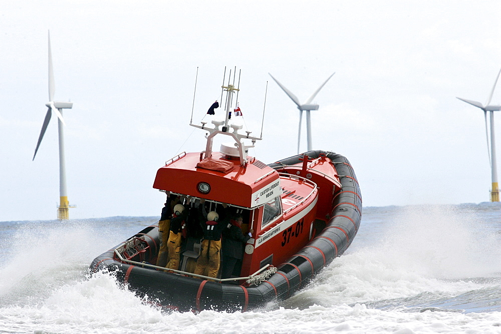 Caister lifeboat and wind turbines of the Caister Wind Farm, Norfolk, United Kingdom. - 1161-3048