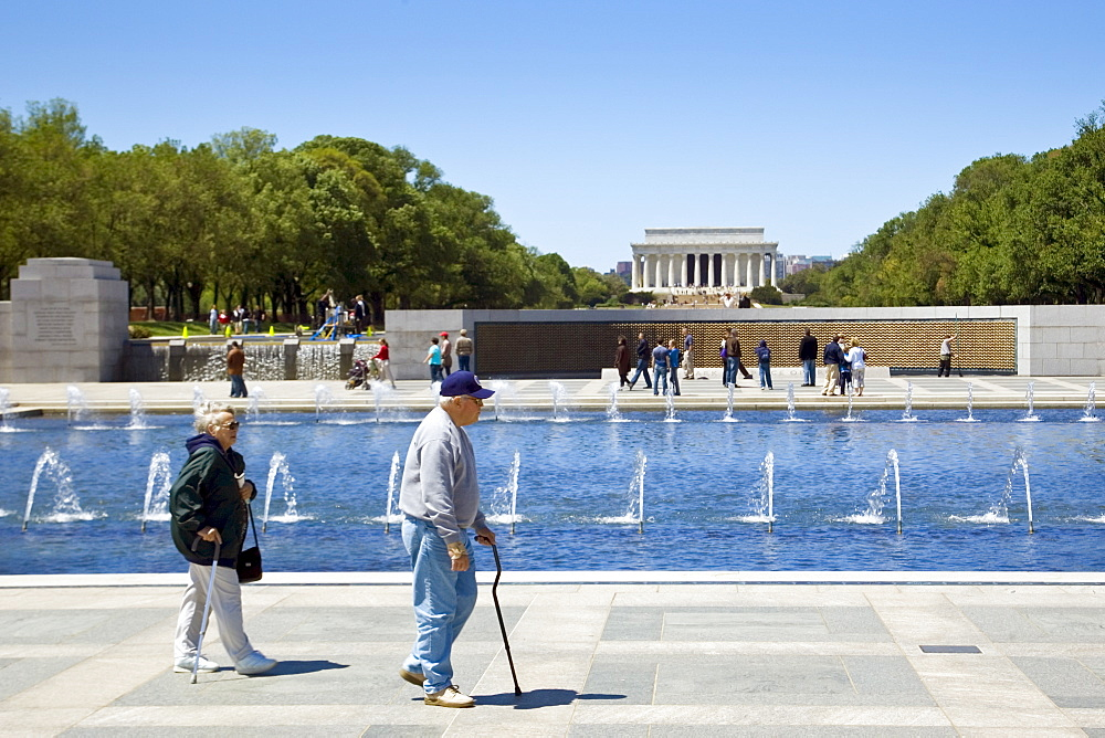 National World War II Memorial with Wall of Stars and Lincoln Memorial behind, Washington D.C, USA