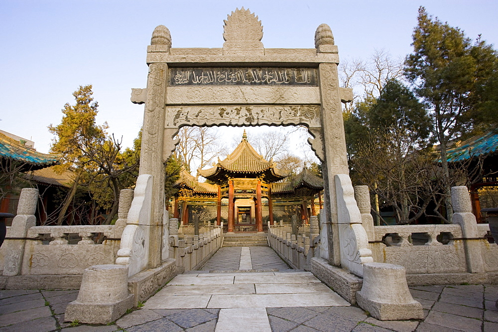 Stone Memorial Gateway leading to the Phoenix Pavilion at the Great Mosque in the Muslim area of Xian, China