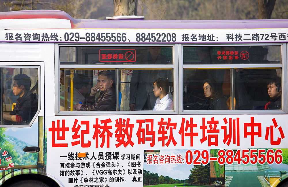 Bus carries workers home in rush hour, Xian city centre, China - 1161-3388