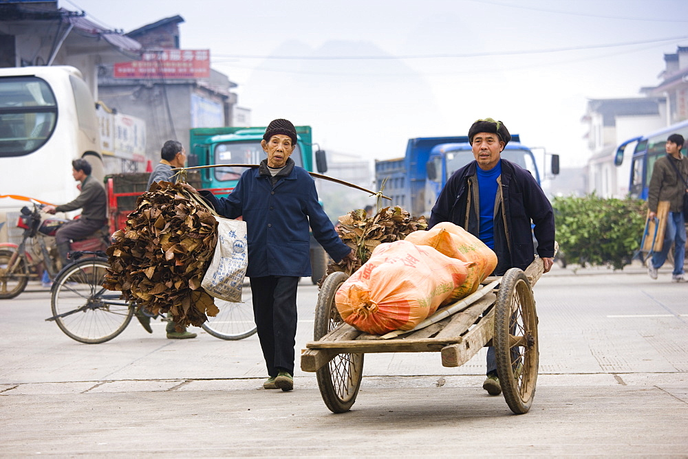People carry goods to market in Baisha, near Guilin, China