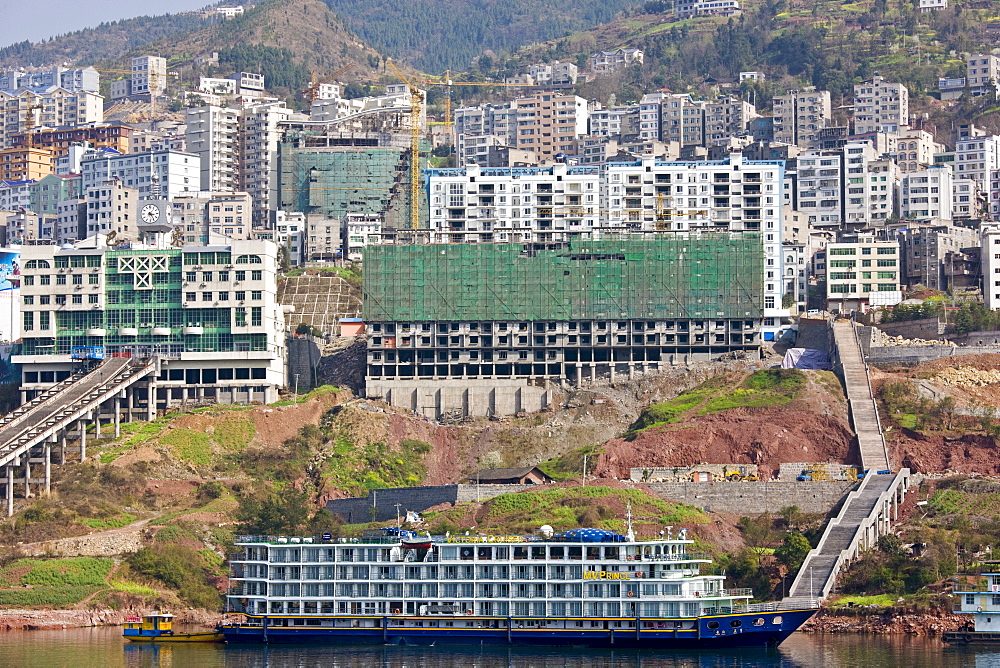 Victoria Line cruise ship by new town built to re-home communities as part of Three Gorges dam project, China - 1161-3521