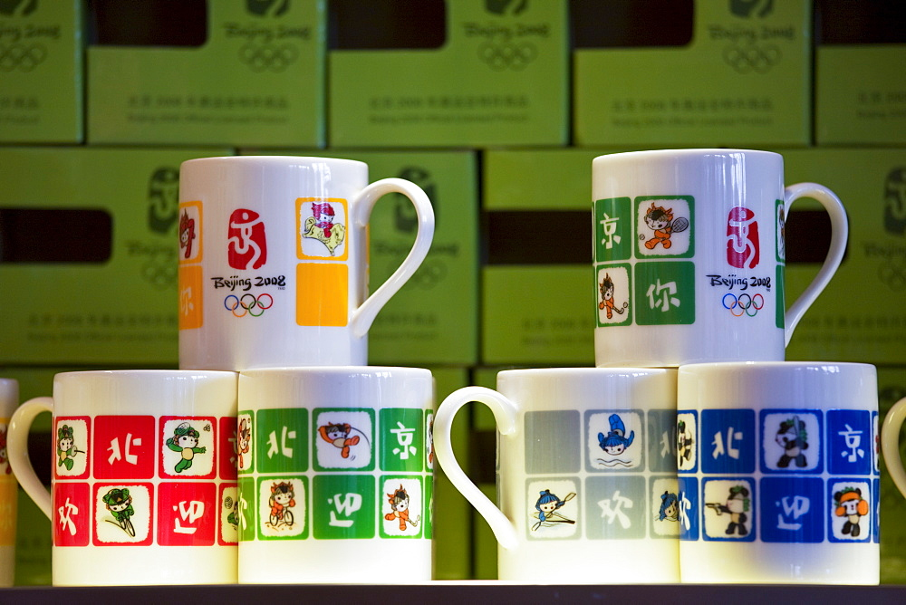 2008 Olympic Games official souvenirs Fuwa mascot characters souvenir mugs on sale in Beijing shop, China
