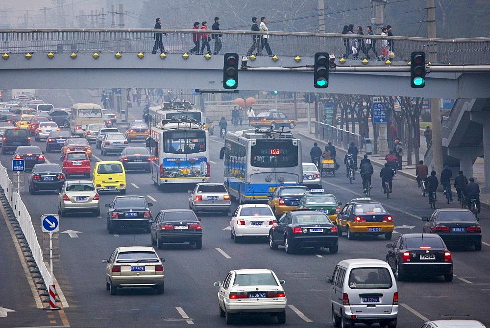 Footbridge over traffic on Beijing main street, China