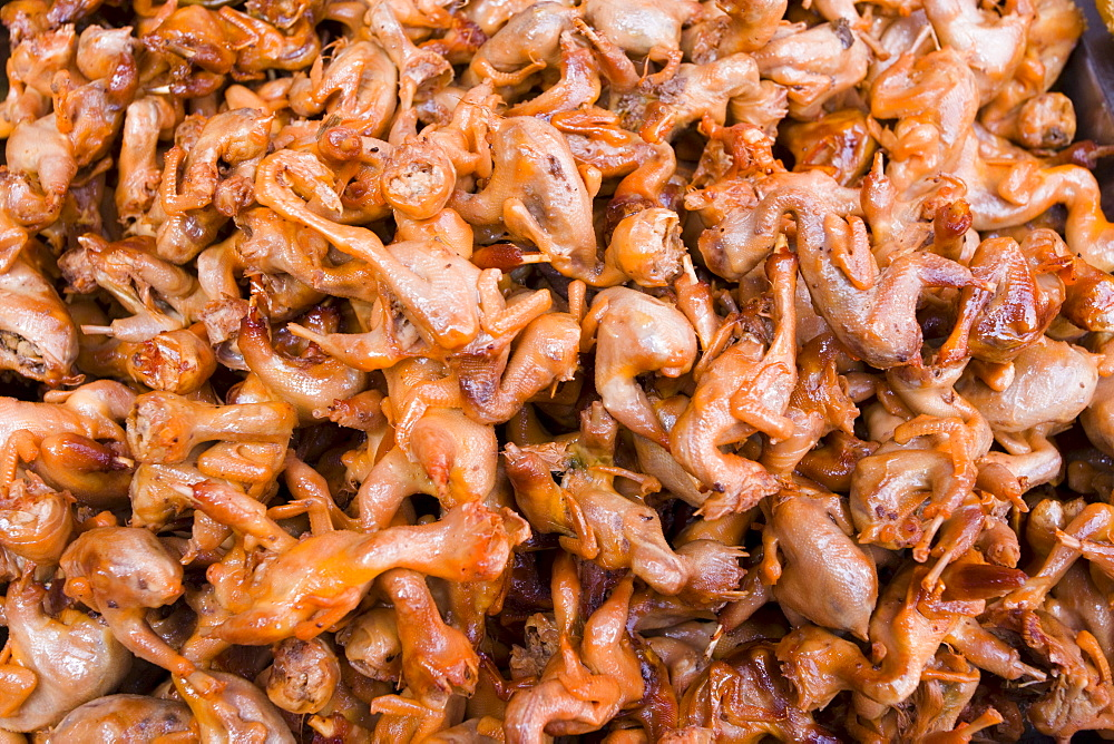 Deep fried sparrows for sale in the Yu Garden Bazaar Market, Shanghai, China