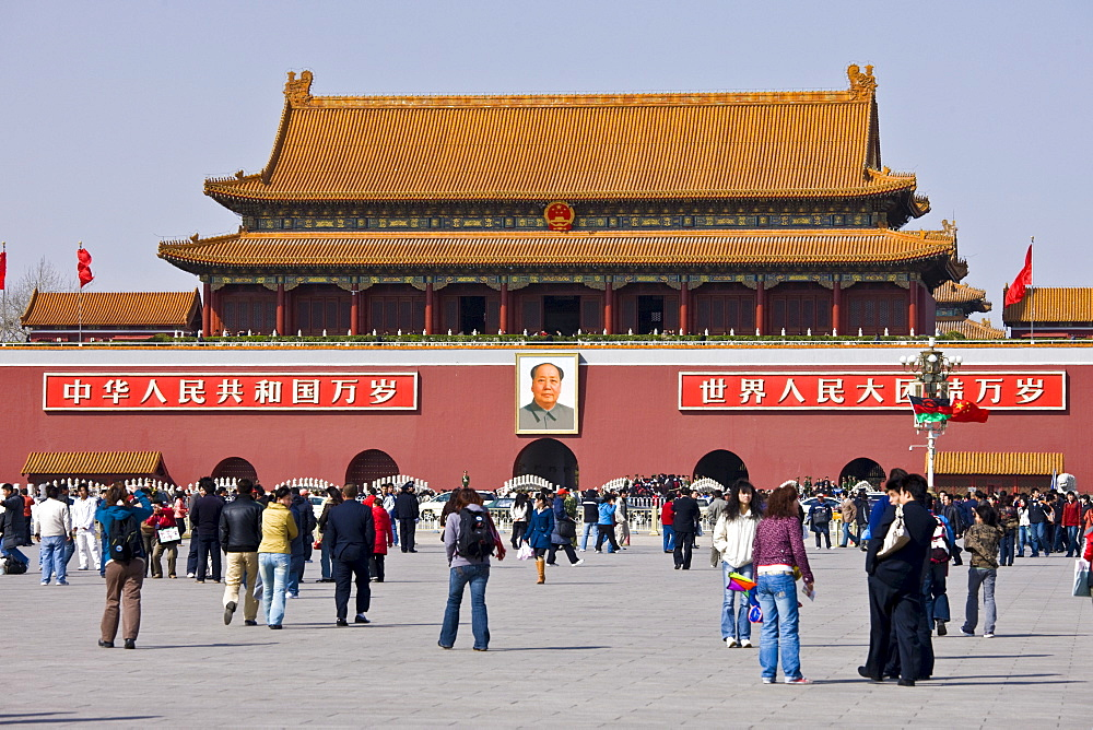 Tourists at Gate of Heavenly Peace with Chairman Mao's portrait, Entrance to the Forbidden City, Beijing, China