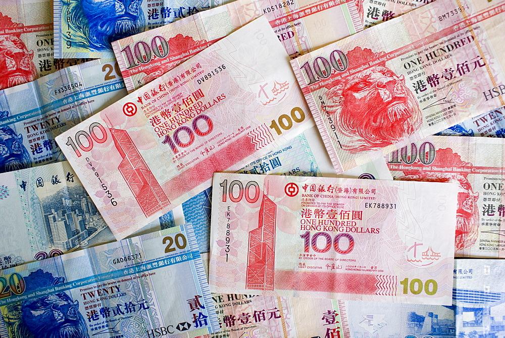 Hong Kong Dollar bills feature image of the Bank of China Building, Hong Kong, China