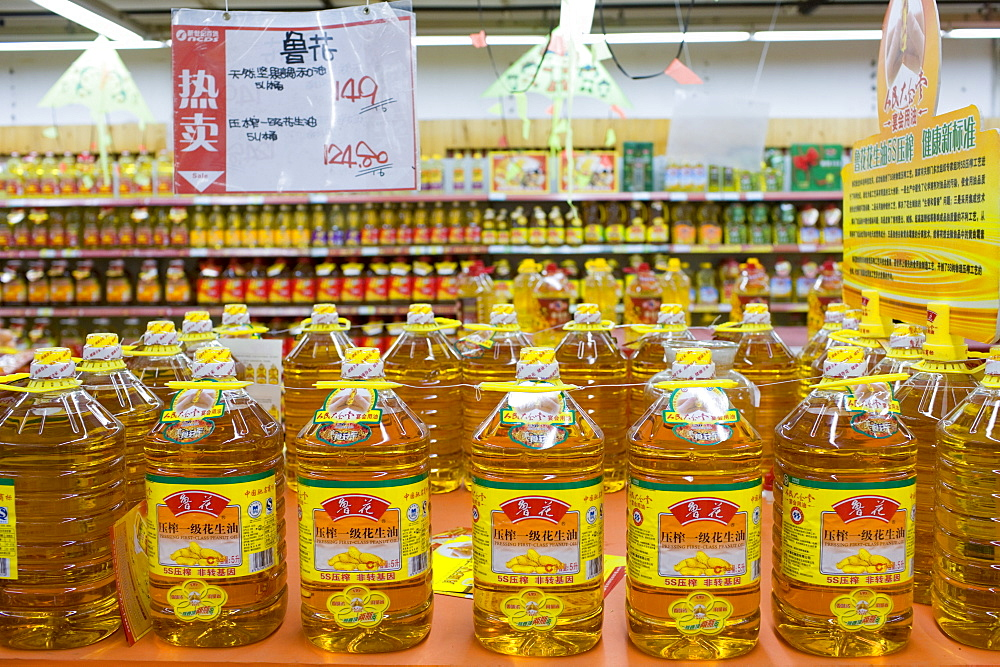 Peanut cooking oil in supermarket, Chongqing, China. The Chinese use a lot of edible oil and find it expensive.