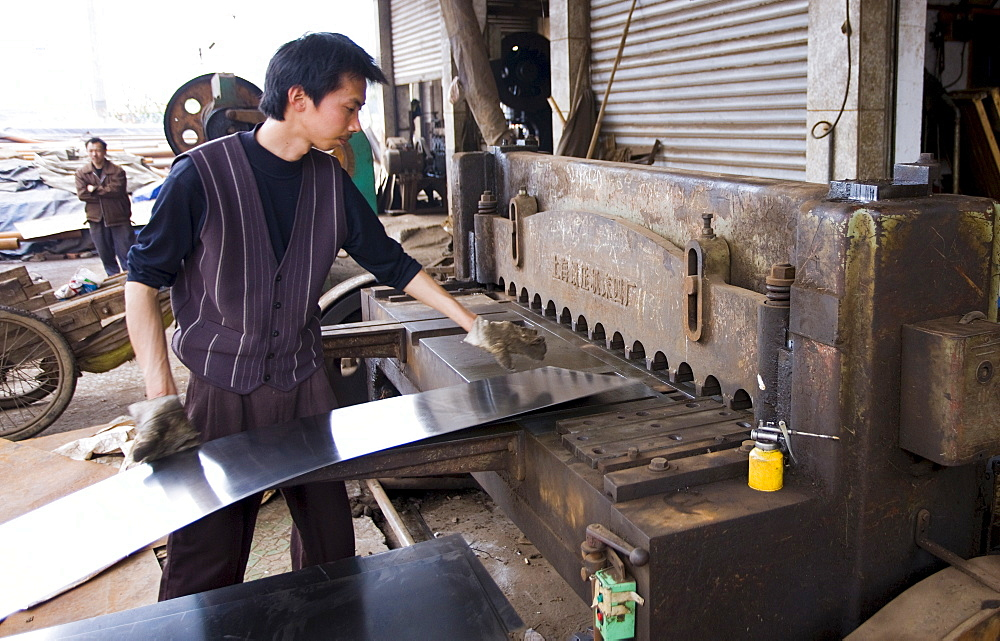 Man working at metal recycling steel in Dazu County, Chongqing, China