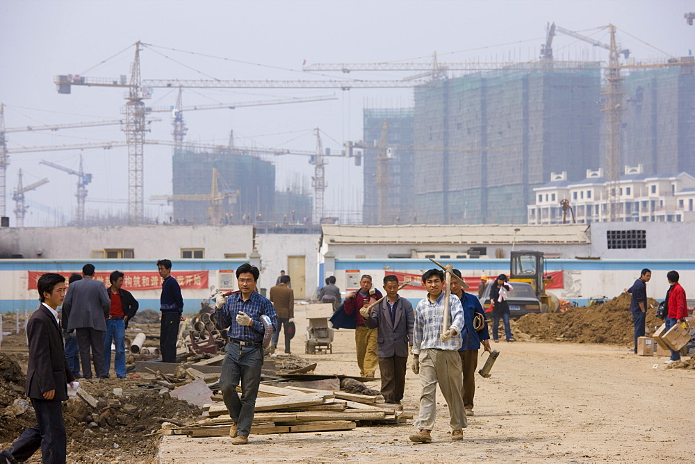 Workmen on a housing development in Yichang, China